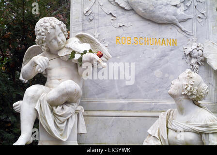 Angle with rose on the graveyard of the famous musicians Robert and Clara Schumann in Bonn Northrine-Westphalia - Stock Photo