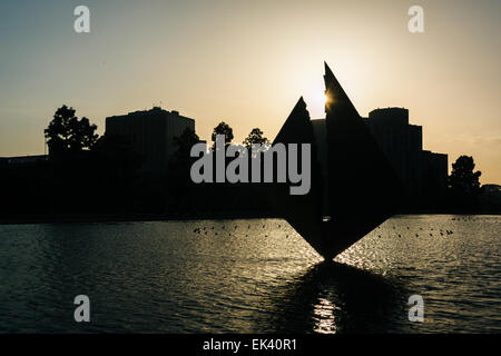 Sculpture in the water outside the Los Angeles Department of Water and Power Building at sunset in downtown Los - Stock Photo