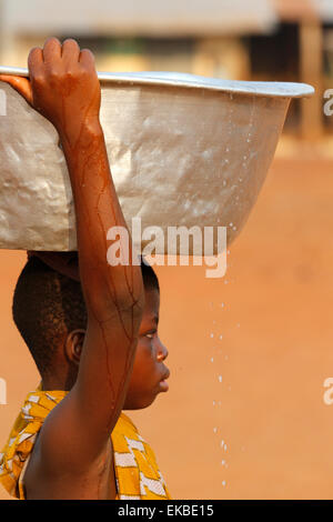 Water chore in an African village, Togo, West Africa, Africa - Stock Photo