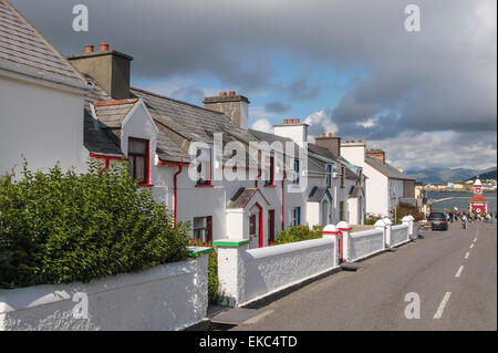 Historic row of houses on Valentia Island at the Ring of Kerry in Cahersiveen, County Kerry, Ireland - Stock Photo