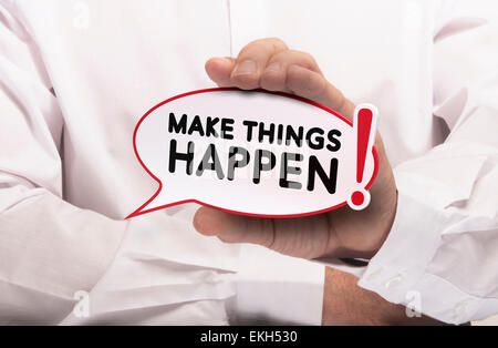 Image of a man hand holding speech balloon with the text make things happen, white shirt. Concept for motivation - Stock Photo