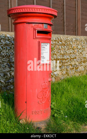 Postbox UK. Red Royal Mail pillar box in the UK. Postbox red. Letterbox red. Red letter box. Red mailbox. Mailbox - Stock Photo
