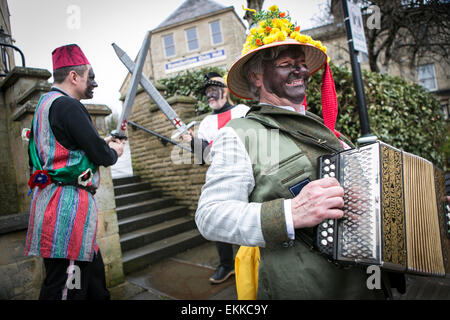 The Bury Pace Eggers perform their traditional English folk custom play in and around the pubs of Ramsbottom at - Stock Photo