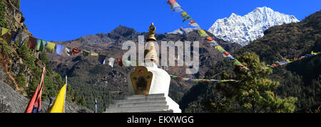 Buddhist Stupa and Prayer Flags, Bengkar village, Everest Base Camp trek, Sagarmatha National Park, Solukhumbu district, - Stock Photo