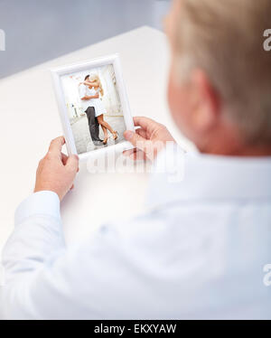 close up of old man holding young couple photo - Stock Photo