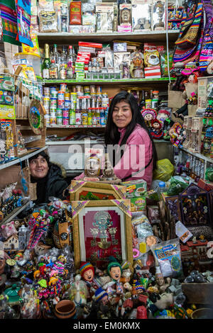 Peru, Cusco, San Pedro Market.  Young Woman and her Mother in Shop Selling Sundry Items. - Stock Photo