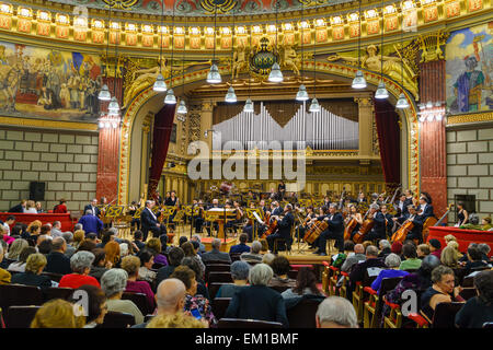 The George Enescu Philharmonic Orchestra playing in the Romanian Athenaeum, Bucharest, Romania. - Stock Photo