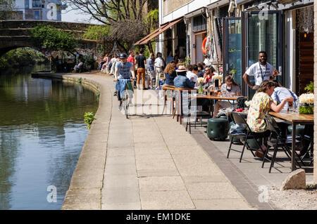 People enjoying beautiful spring weather along the banks of the Regent's Canal, London England United Kingdom UK - Stock Photo