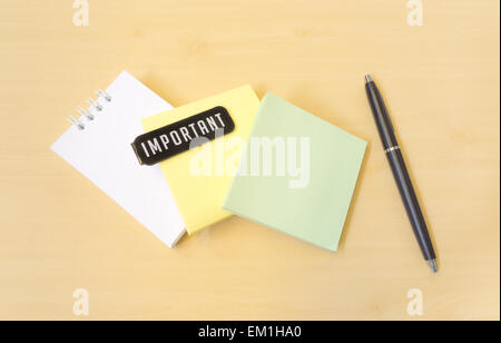 Important Three Colors Paper Notes and Black Pen on Wooden Texture - Stock Photo