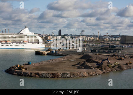 A Cruise Ship In The Port With Construction Of A New Terminal; Helsinki, Finland - Stock Photo