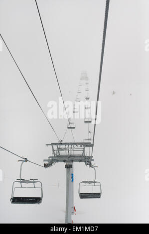 A Chairlift At A Ski Resort; Whistler British Columbia Canada - Stock Photo