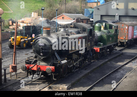 Two tank engines sat outside the engine shed at the Severn Valley Railway in Brigdnorth. - Stock Photo