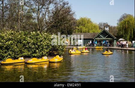 People Sitting by The Boating Lake Regents Park London UK - Stock Photo