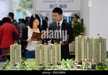 (150416) -- XI'AN, April 16, 2015 (Xinhua) -- A resident consults about house property information at the Xi'an - Stock Photo