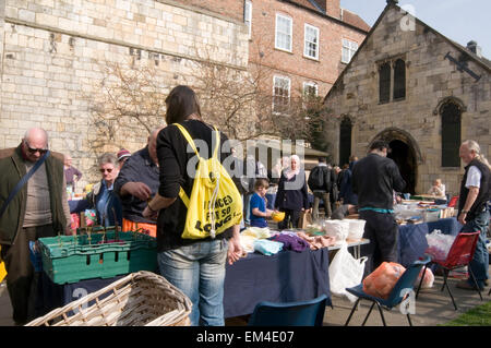 jumble sale sales fundraising fundraiser charity table top tabletop second hand goods - Stock Photo