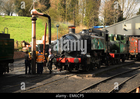 Taken at the Severn Valley Railway at Bridgnorth in Shropshire. Two tank engines sit at the water tower. - Stock Photo