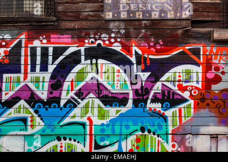 Example of street art on the walls of an old warehouse district on the east side of Vancouver, Canada - Stock Photo