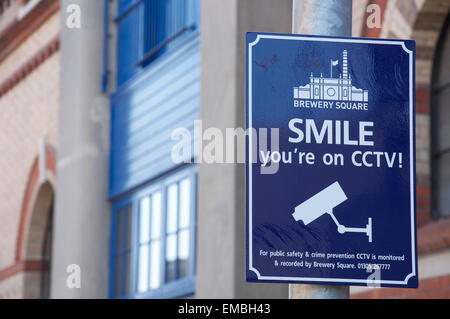 Quirky British humour. SMILE you're on CCTV. An amusing sign informs us we are under video surveillance, at Brewery - Stock Photo