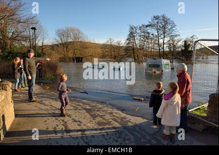 onlookers at flooded car park Batheaston Bath and Northeast Somerset England UK - Stock Photo