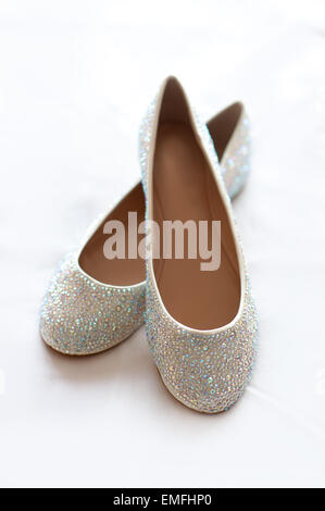 flat wedding shoes with diamante - Stock Photo