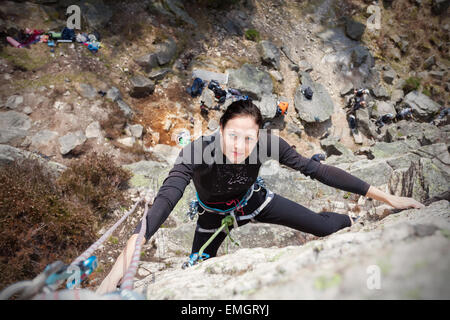 Young woman climbing wall, active woman concept picture. - Stock Photo