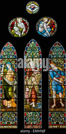 Victorian stained glass designed by Henry Holiday in the Parish Church of  Keswick St. John, Cumbria, England, UK - Stock Photo