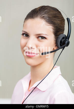 Female Call Center Employee With Headphones - Stock Photo