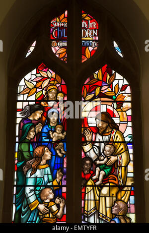 UK, Cumbria, Workington, St Michael's Church, Jesus and the Children Window - Stock Photo