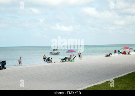 people enjoying a day on the beach in Naples, Florida - Stock Photo