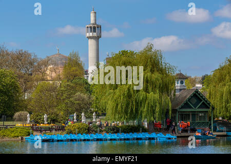 The Regents Park Boating Lake and London Central Mosque on a sunny blue sky day , London, England UK - Stock Photo