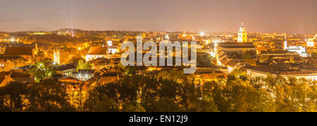 View over Vilnius old town by night - Stock Photo