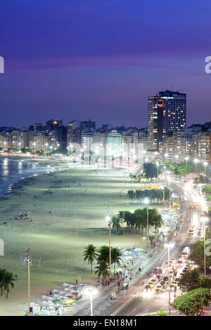 View of Leme and Copacabana beach neighbourhoods at night, Rio de Janeiro, Brazil - Stock Photo