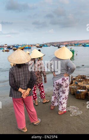 Waiting For The Fishermen To Return - Mui Ne Fishing Village. - Stock Photo