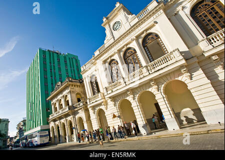 Horizontal street view of the Santa Clara Libre Hotel in Parque Vidal in Santa Clara, Cuba - Stock Photo