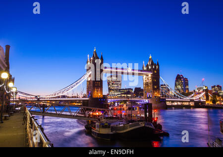 A beautiful dusk-time view of Tower Bridge and the River Thames in London. - Stock Photo