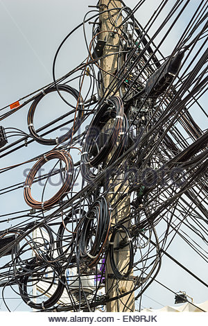 Chaotic electric wiring in Bangkok - Thailand - Stock Photo