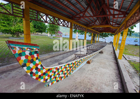 A traditional and folklore boat from Banda Neira, Indonesia. This colorful boat it used during festivals and social - Stock Photo