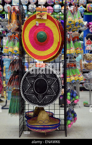 Sombreros, maracas and other party items for sale at the Party Store in Greenwich Village, Manhattan, New York City - Stock Photo