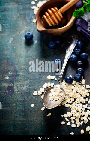 Healthy Breakfast.Oat flake, berries and fresh milk. Health and diet concept - Stock Photo