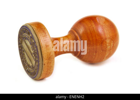 Old and vintage wooden stamper on white background - Stock Photo
