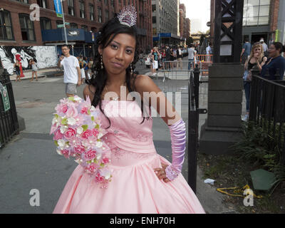 Mexican girl has photo taken for her fifteenth birthday or Quinceañera at Brooklyn Bridge Park in in DUMBO in Brooklyn, - Stock Photo