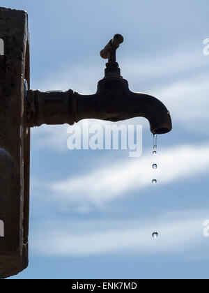 Water dripping from a faucet - Stock Photo