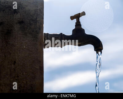 Water running from a faucet - Stock Photo