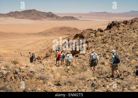 Africa, Namibia. Tok Tokkie Trails. Group of hikers. - Stock Photo