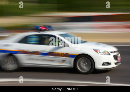 Police car speeding in blurred motion - Stock Photo