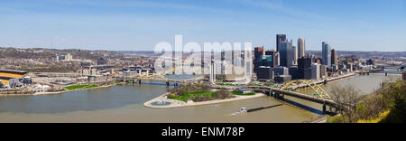 The skyline of Pittsburgh, Pennsylvania showcases the city sitting at the intersection of its three rivers. - Stock Photo