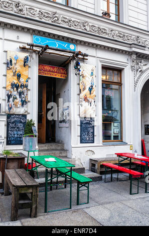 Buchhandlung caffetteria and bar exterior in old building with outside tables and benches,  Tucholskystrasse, Berlin - Stock Photo