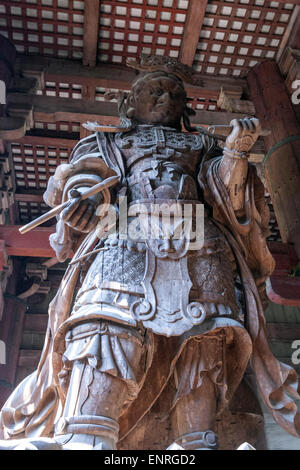 Komokuten, one of the pair of guardians in the Daibutsuden, Tōdai-ji, Eastern Great Temple, is a Buddhist temple - Stock Photo