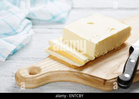 Fresh dairy butter on board, food - Stock Photo