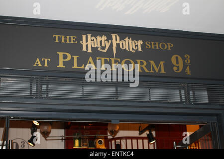 Platform 9 3/4 Harry Potter souvenir shop in King's Cross station London UK - Stock Photo